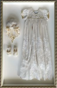 Custom framing_shadowbox_christening dress_hat and booties_Westwood Gallery